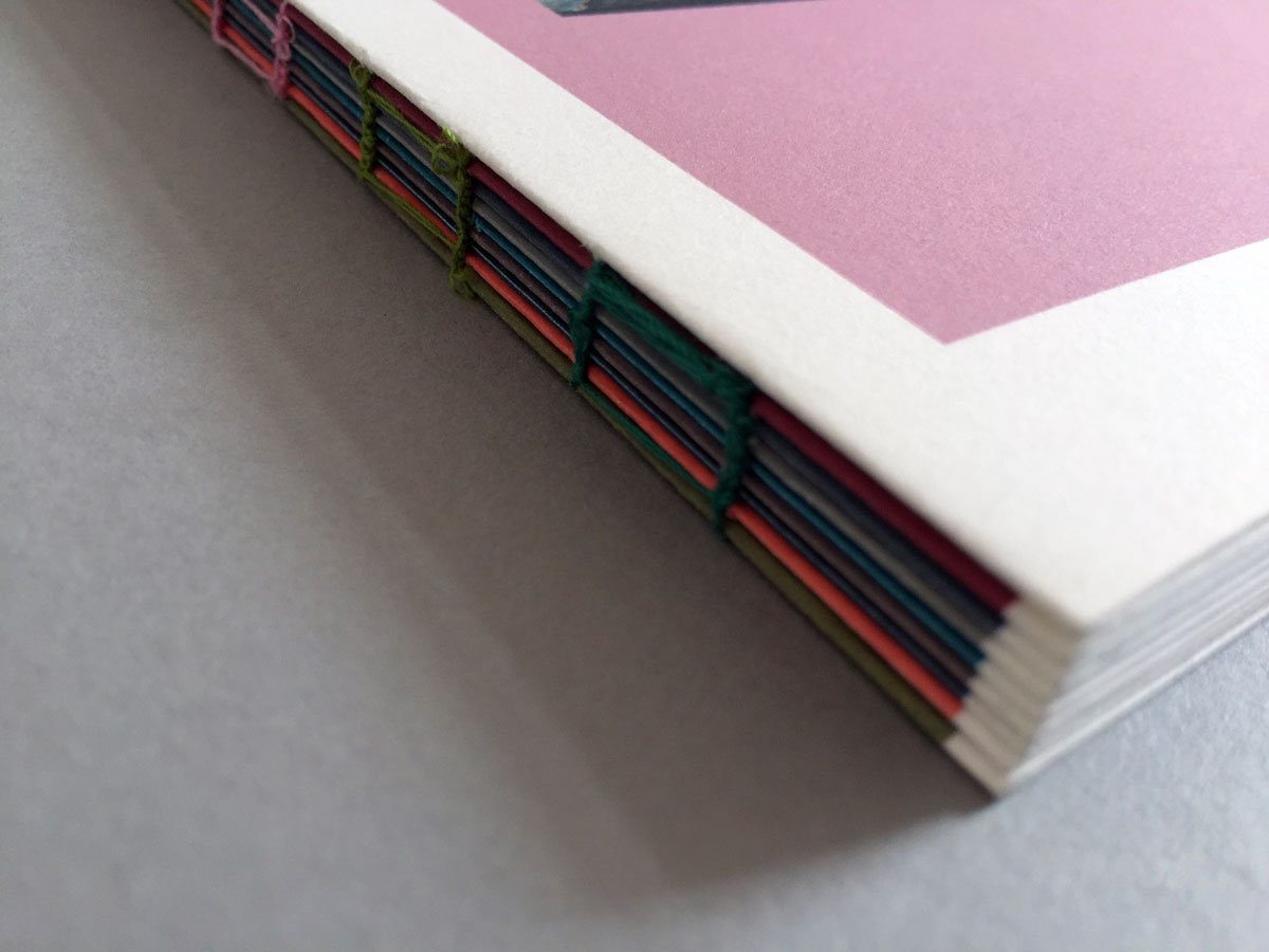 multi coloured stitched book