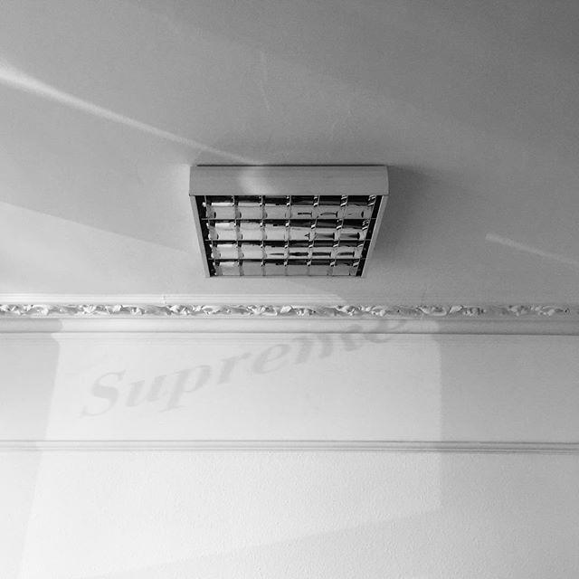Studio ceiling with accidental logo projection —  #design #designagency #designstudio #graphic #graphicdesign #type  #typeface #typography #designers #designer